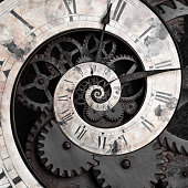 istock Old style clock face spiraling down 482725463