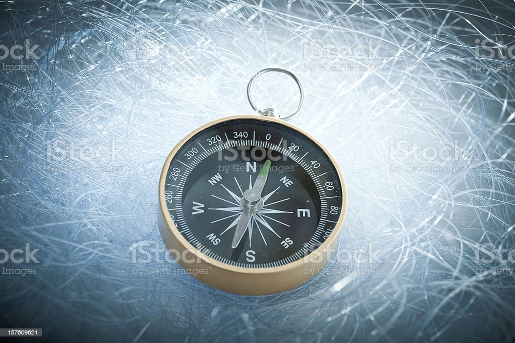 Old style compass on nylon wire background royalty-free stock photo