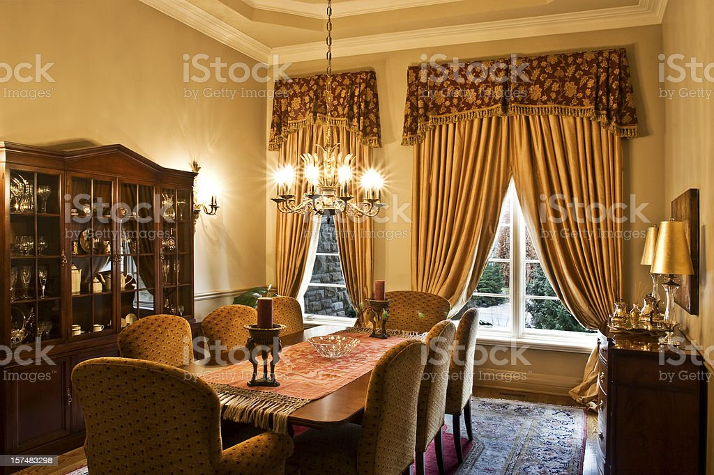 Old style dining room with large table and chandelier royalty-free stock photo