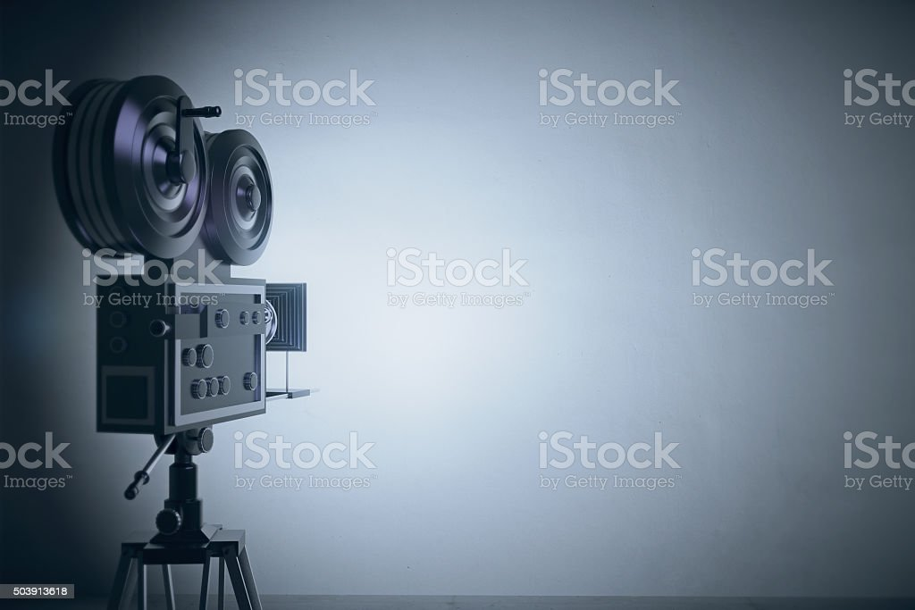 Old style film camera at grey wall backgound stock photo