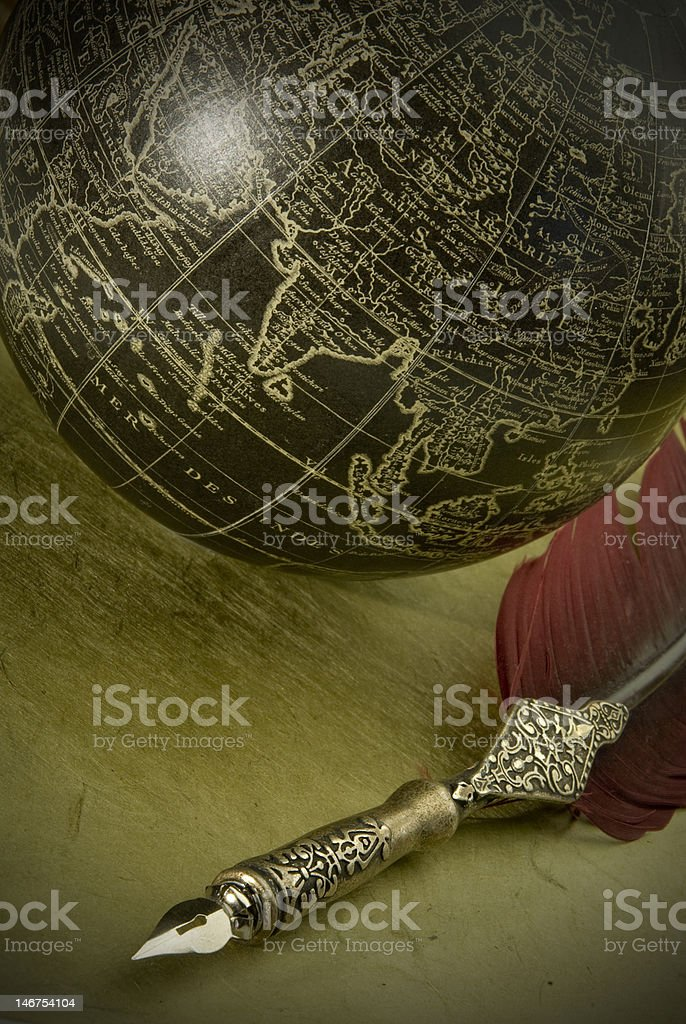Old style globe and pen royalty-free stock photo