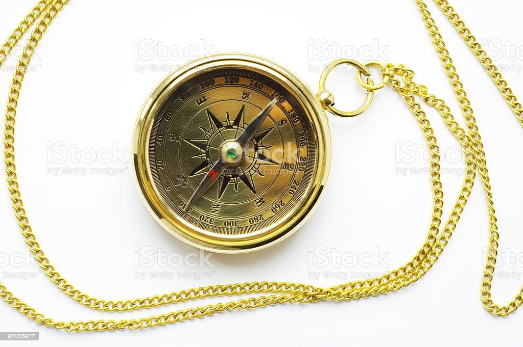 Old style gold compass with chain on white background royalty-free stock photo