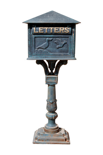 An old style mail box isolated on white