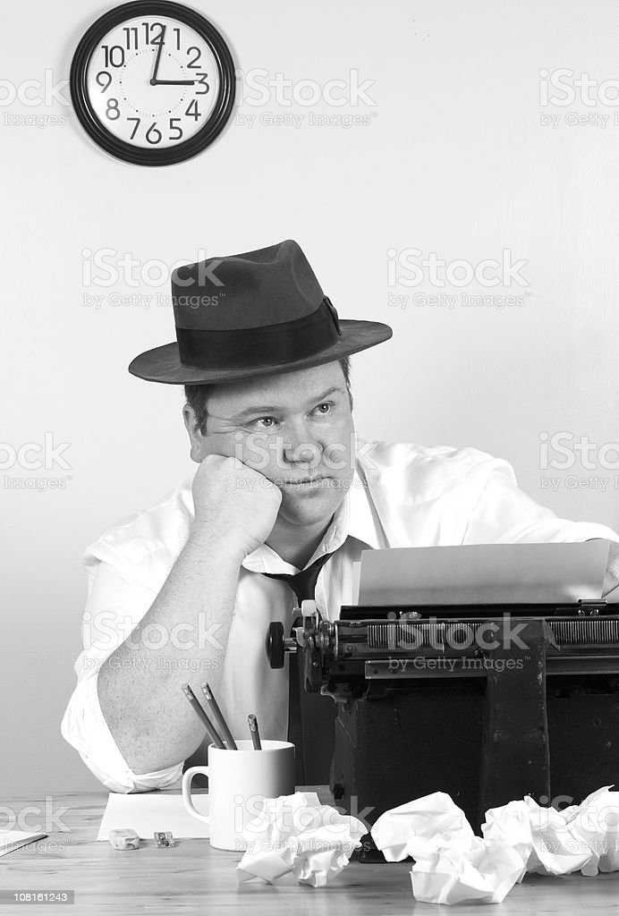 Old Style Reporter Man Frustrated at Typewriter royalty-free stock photo