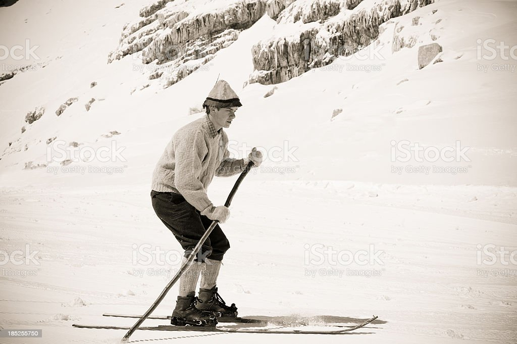 Old Style skier in the mountains stock photo