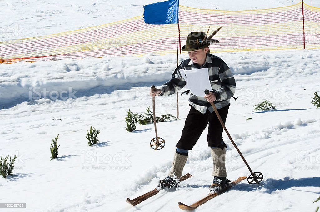 \'Front view of young male retro skier in the action, ski equipment...