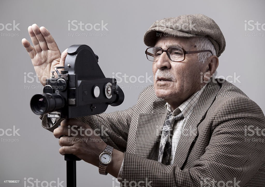 Old style videographer posing with his video camera royalty-free stock photo