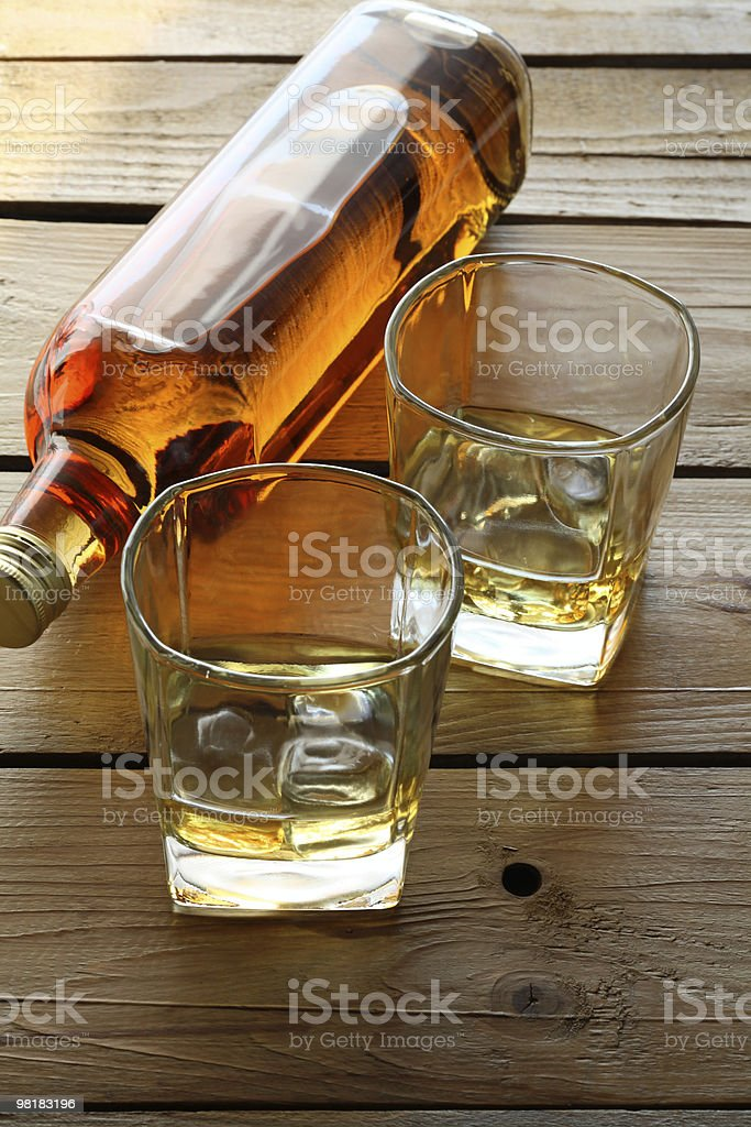 Old Style Whisky Bottle and Glasses royalty-free stock photo