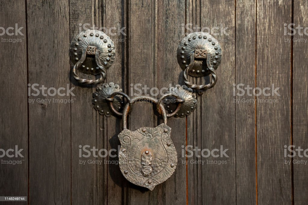 Old Style Wooden Door With Rusty Lock With Engraving Closeup Stock Photo Download Image Now Istock