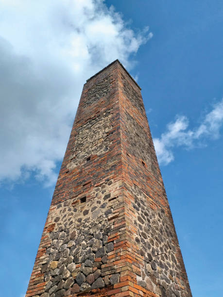 Old sugar mill chimney in sugarcane plantation Old sugar mill chimney in sugarcane plantation miller park stock pictures, royalty-free photos & images