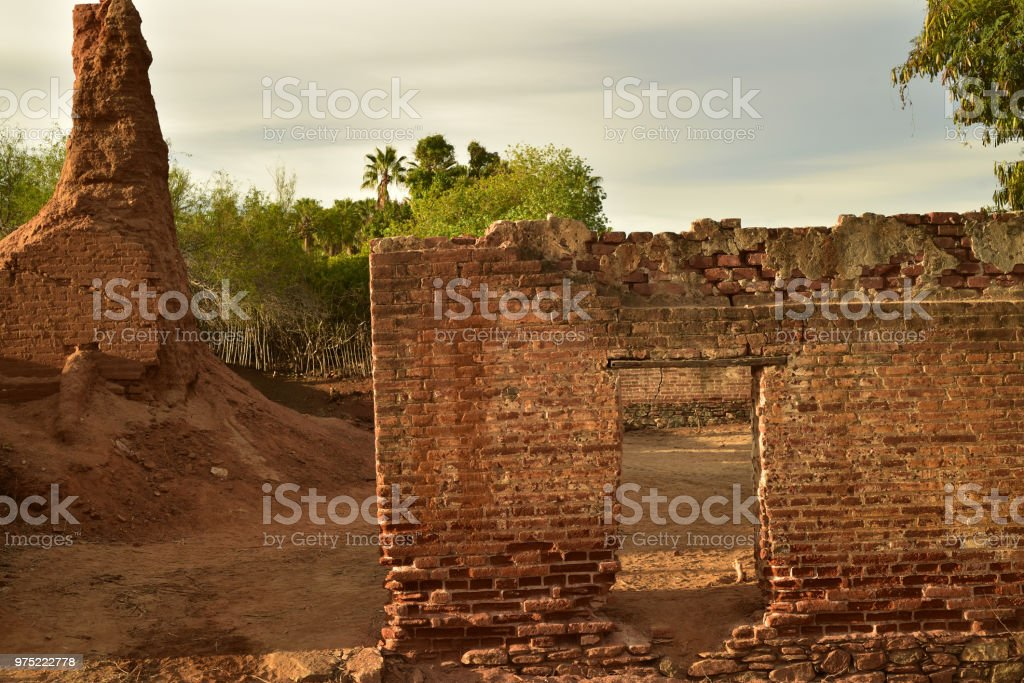 old deteriorating brick ruins of a former sugar cane mill in tropical...