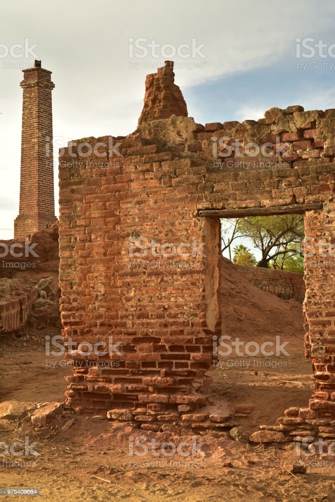 old abandoned brick buildings in ruins that once housed a sugar cane...