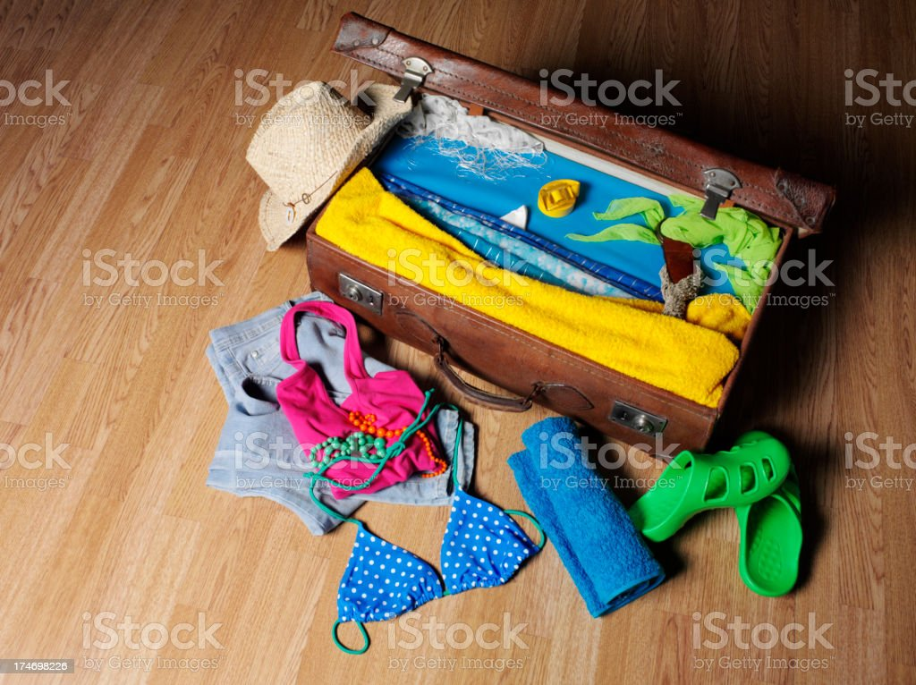 Old Suitcase and Summer Clothes royalty-free stock photo