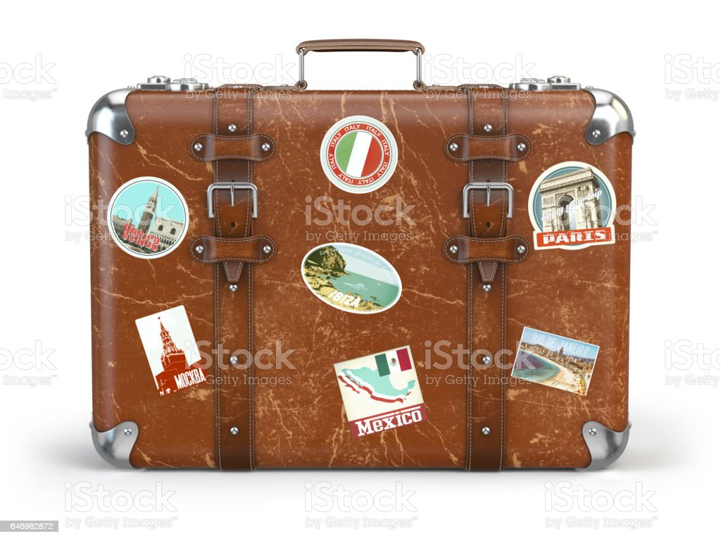 Old suitcase baggage with travel stickers isolated on white background. - foto stock