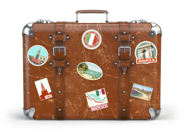 old suitcase baggage with travel stickers isolated on white background. - bagaglio foto e immagini stock