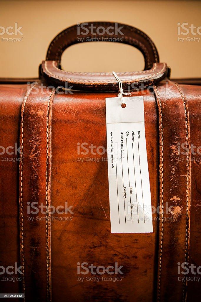 Old mala com Tag em branco - foto de acervo