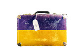 Old suitcase with the flag of Ukraine. Isolated on a white background