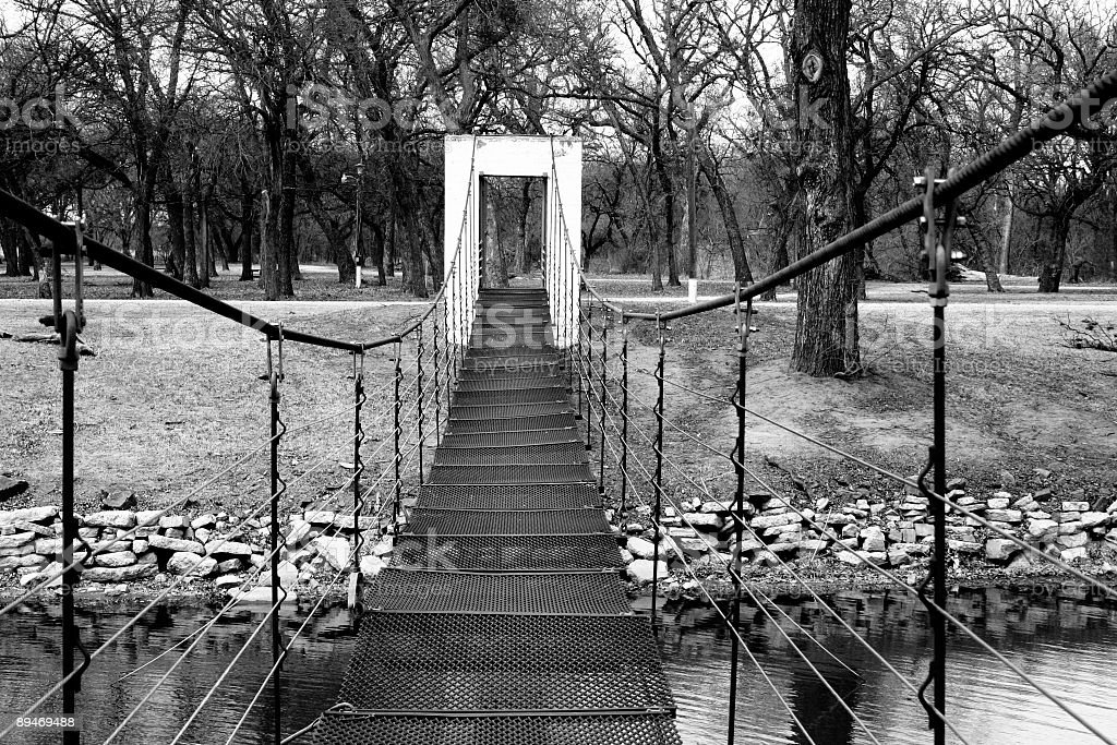 Old Suspension Bridge in Park royalty-free stock photo