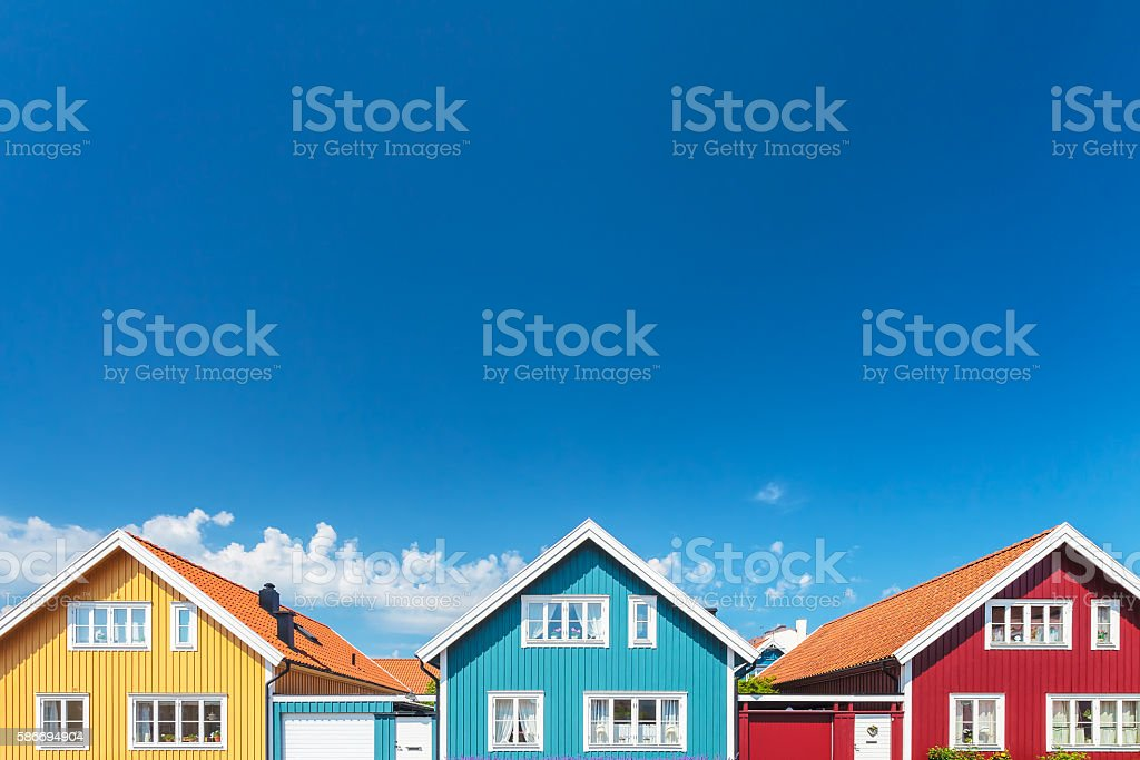 Old swedish houses in front of a blue sky bildbanksfoto