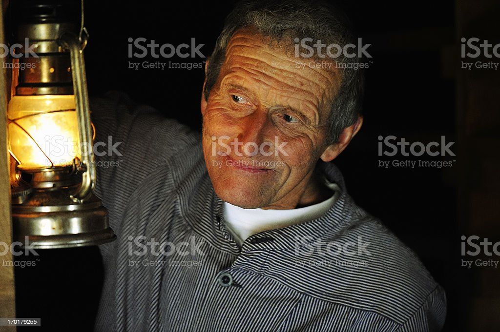 Old Swiss Dairy Farmer in Traditional Clothing Checking his Farm royalty-free stock photo