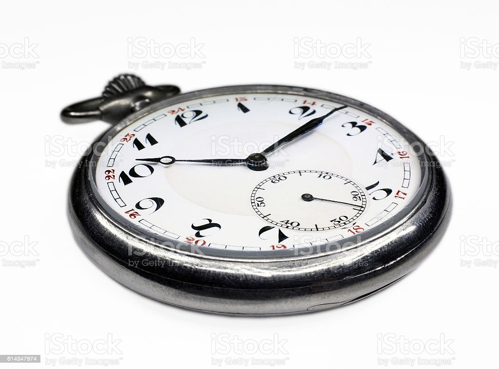 Old swiss pocket watch isolated close up stock photo