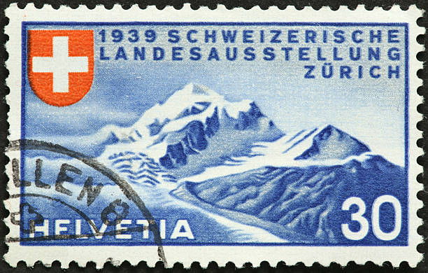 old Swiss stamp with mountains and glacier stock photo