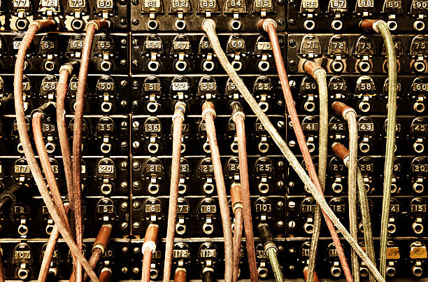 Old switchboard with dangling wires stock photo