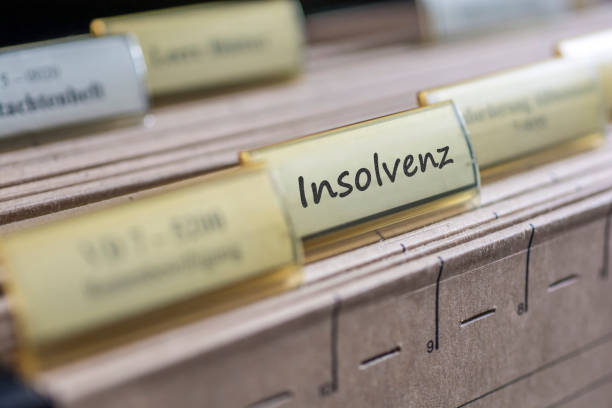 old tab with the german word for insolvency - bankruptcy stock pictures, royalty-free photos & images