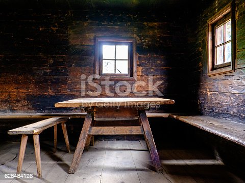 old table and chair at a log cabin