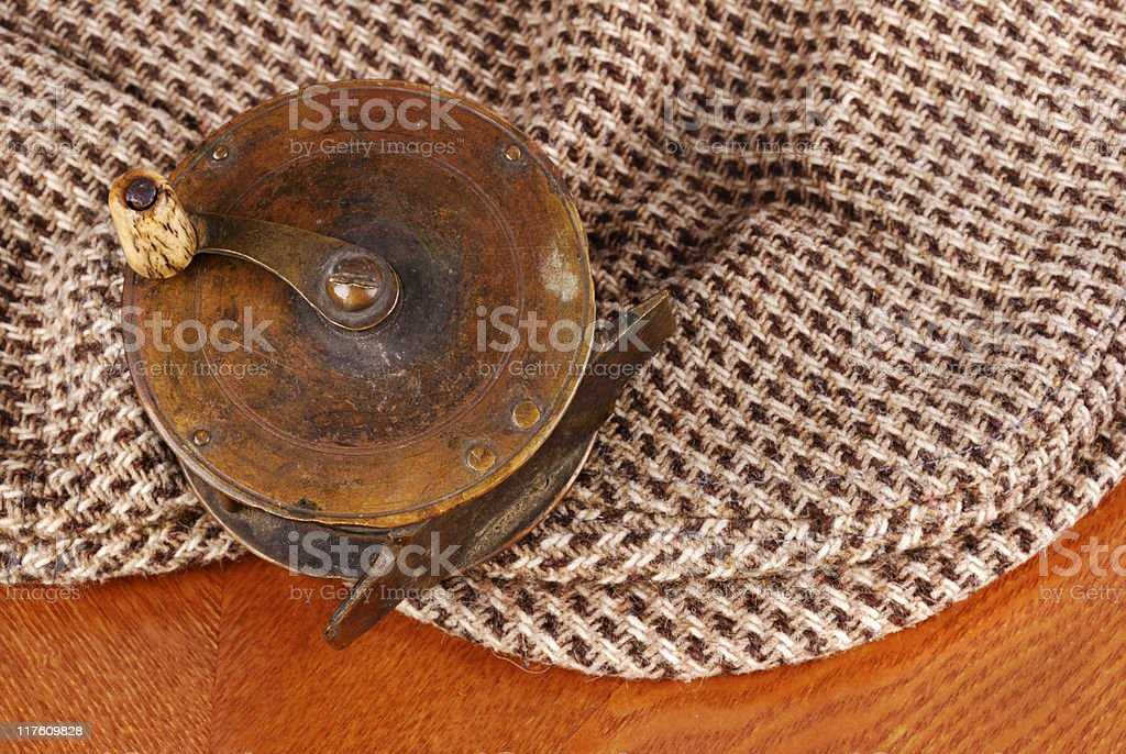 aafe1ac68 Old Tarnished Brass Fly Fishing Reel With A Tweed Cap Stock Photo ...