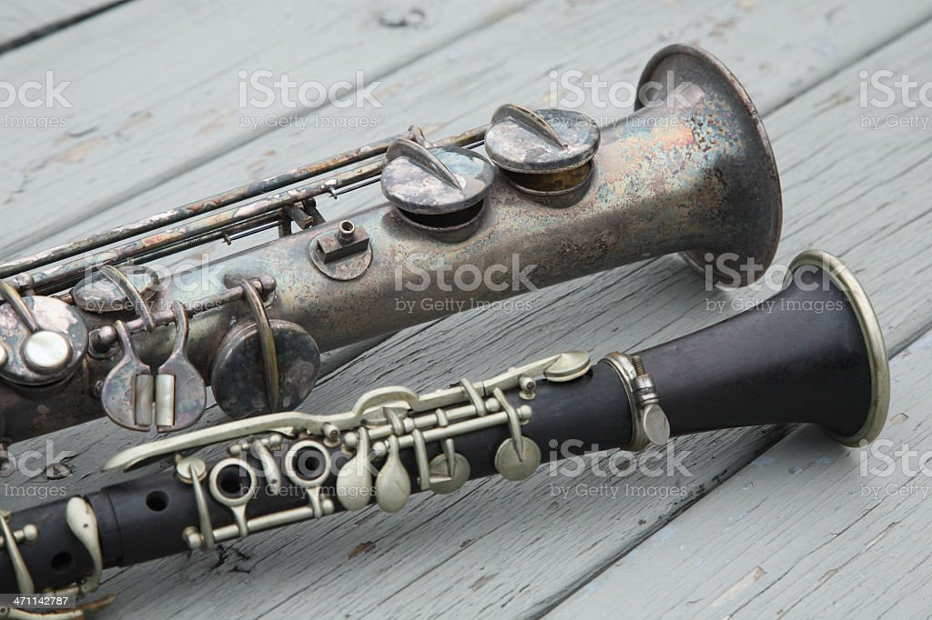 Old tarnished clarinets sitting on wooden deck royalty-free stock photo