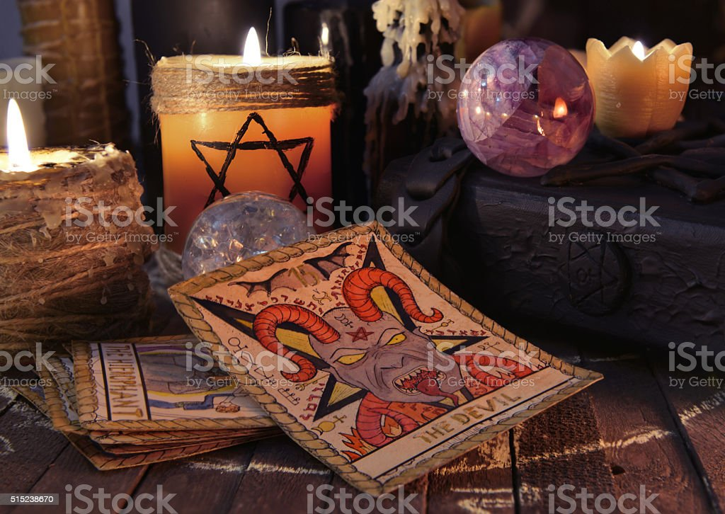 Old tarot cards with candles and book stock photo
