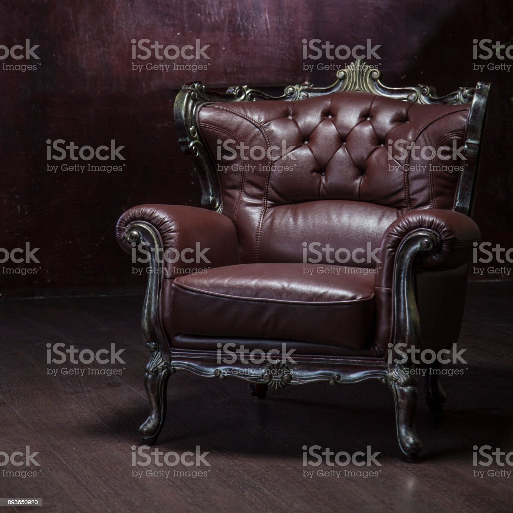 Old tattered leather armchair stock photo