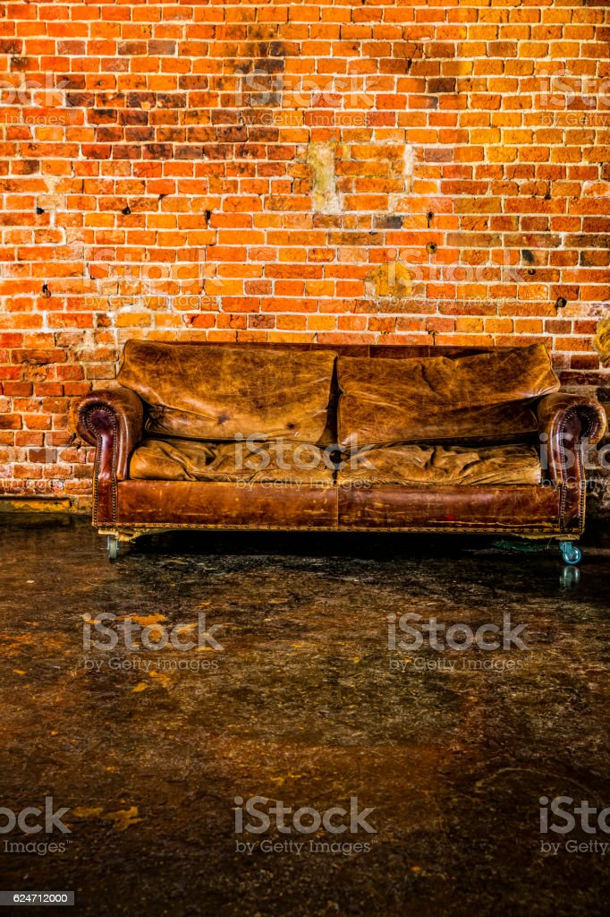 Old Tattered Leather Couch Stock Photo - Download Image Now