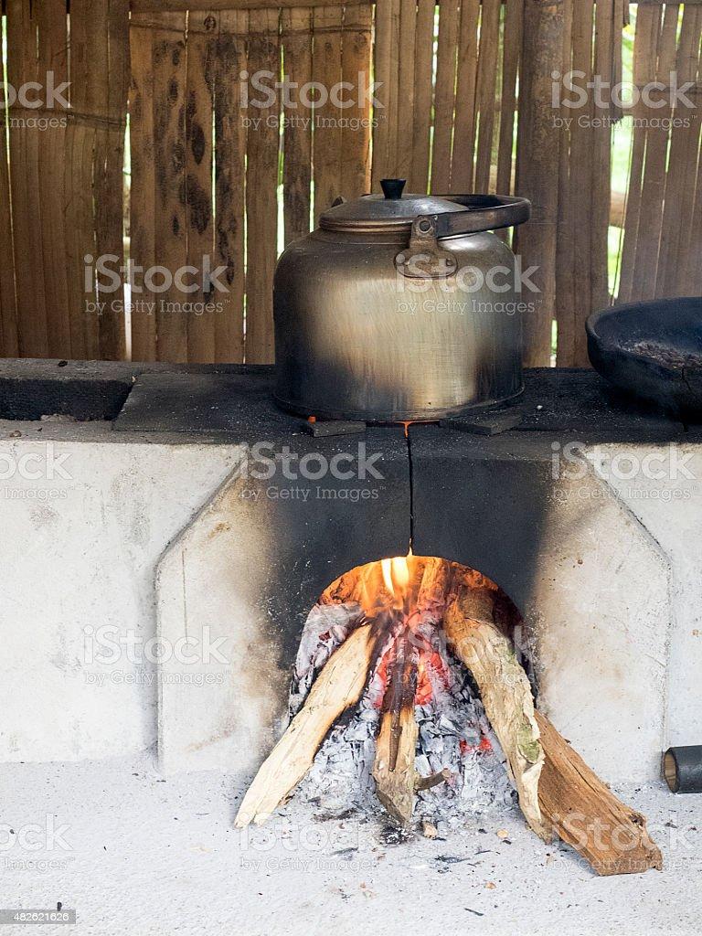 old teapot boils on stove stock photo