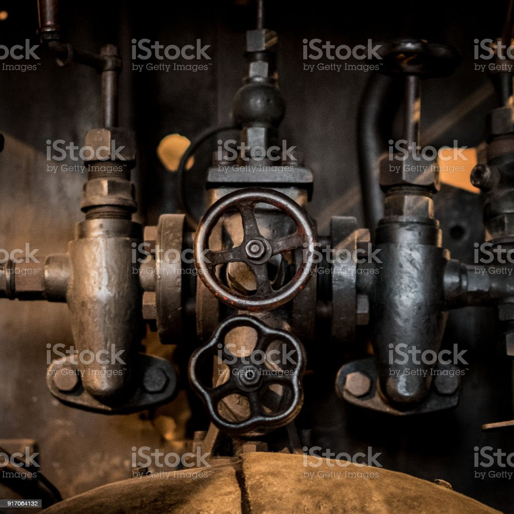 old technology concept - valves, taps and pipes closeup -