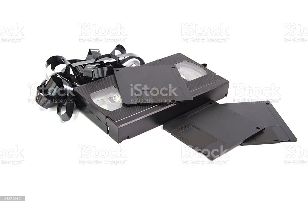 Old technololy video tape and floppy disk stock photo