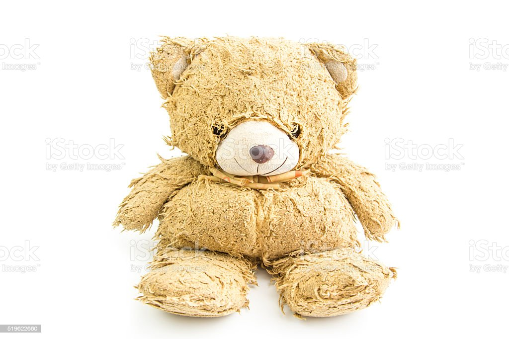 Old teddy bear with bow isolated. stock photo