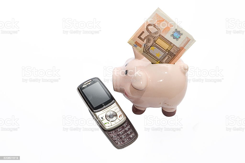 Old telephone and piggi-bank with money stock photo