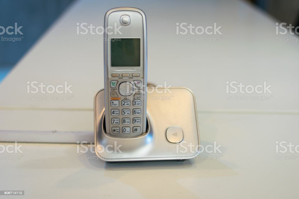old telephone on business room stock photo