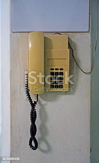 istock Old telephone on wall 623368406