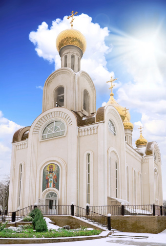Old Temple with blue sky and sun. Rostov-on-don
