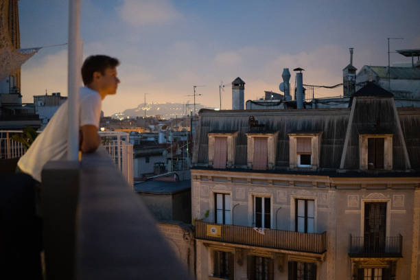 Old tenement houses in Barcelona. Man looking at view stock photo