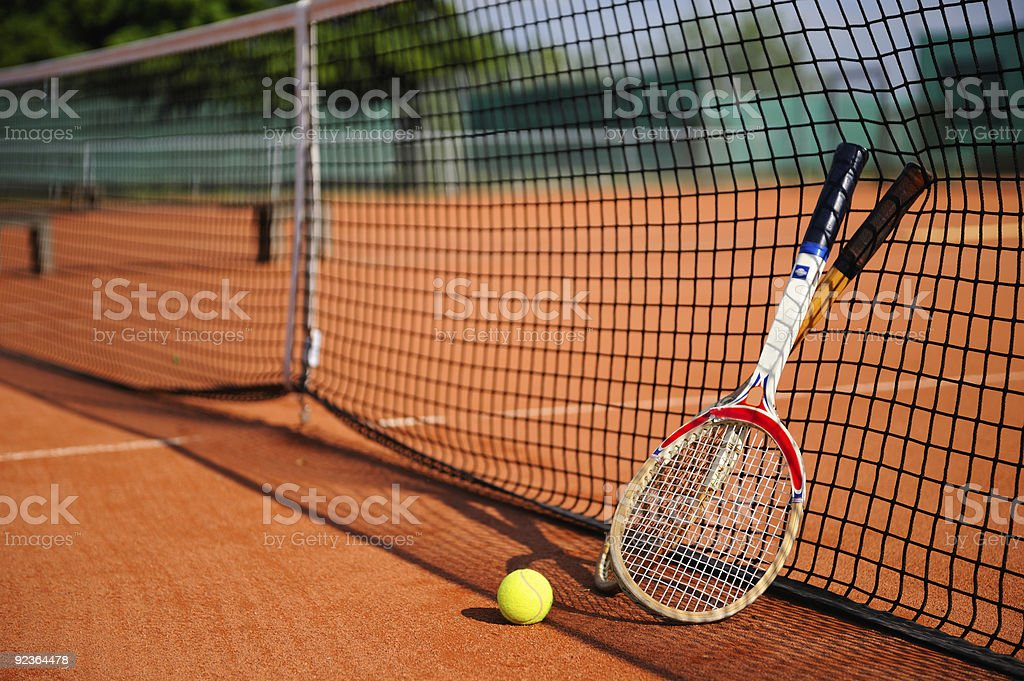 old tennis racket, ball and a net stock photo