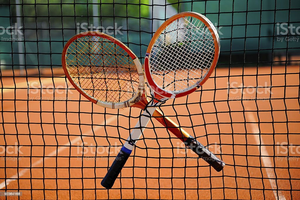 old tennis racket in the net royalty-free stock photo