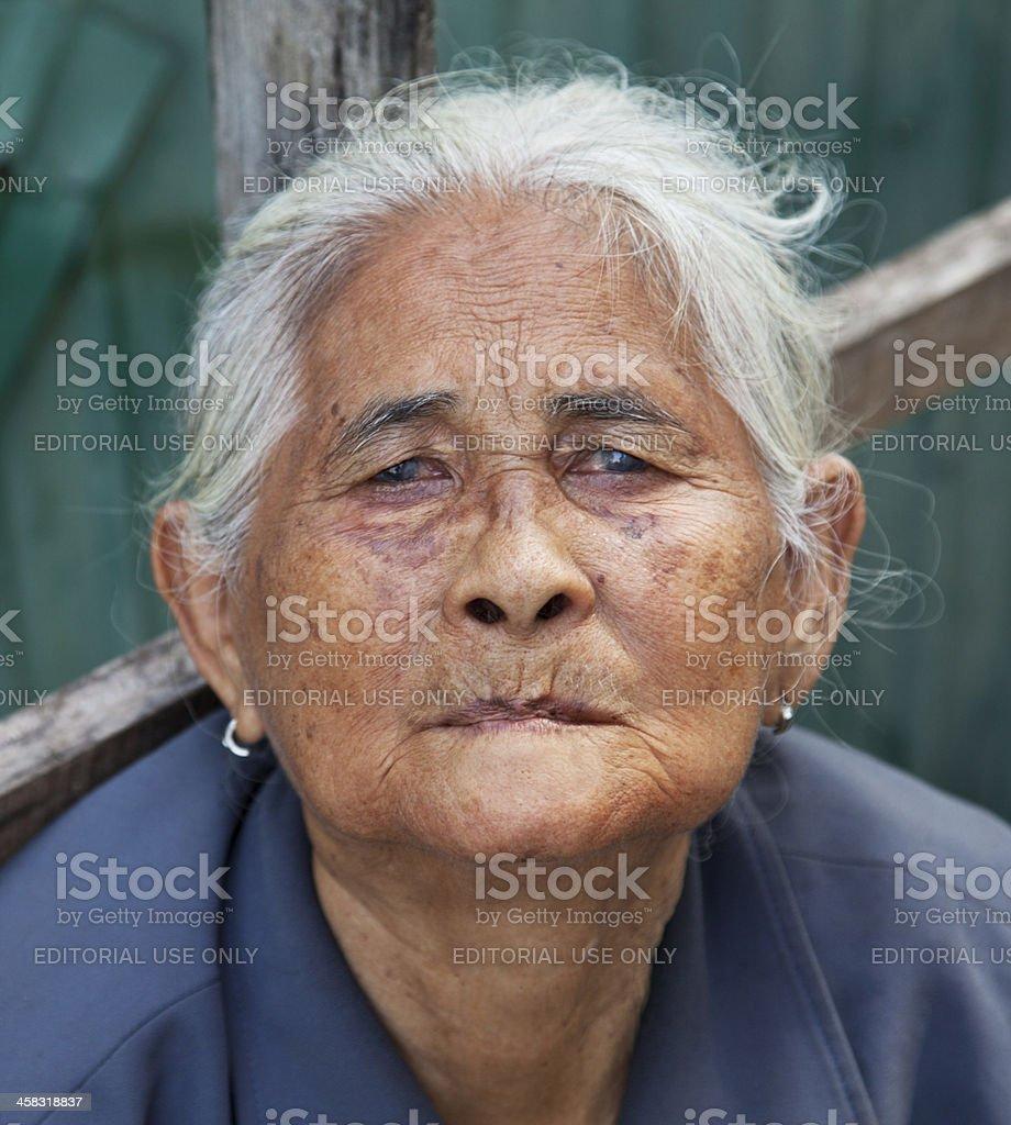 Old Thai beggar woman. royalty-free stock photo