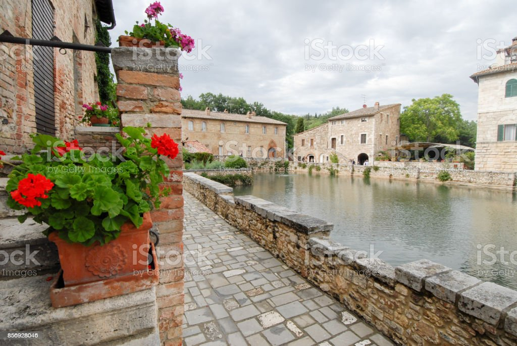 old thermal baths in the medieval village Bagno Vignoni, Tuscany, Italy stock photo