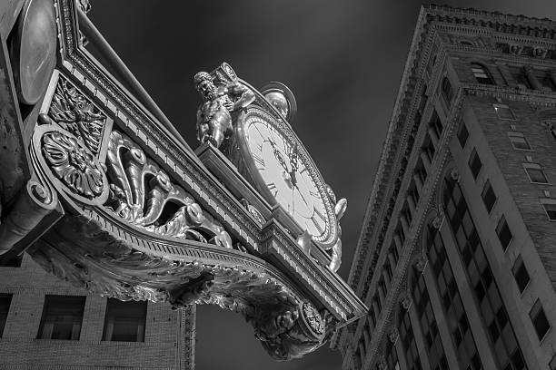 Old time clock downtown night stock photo