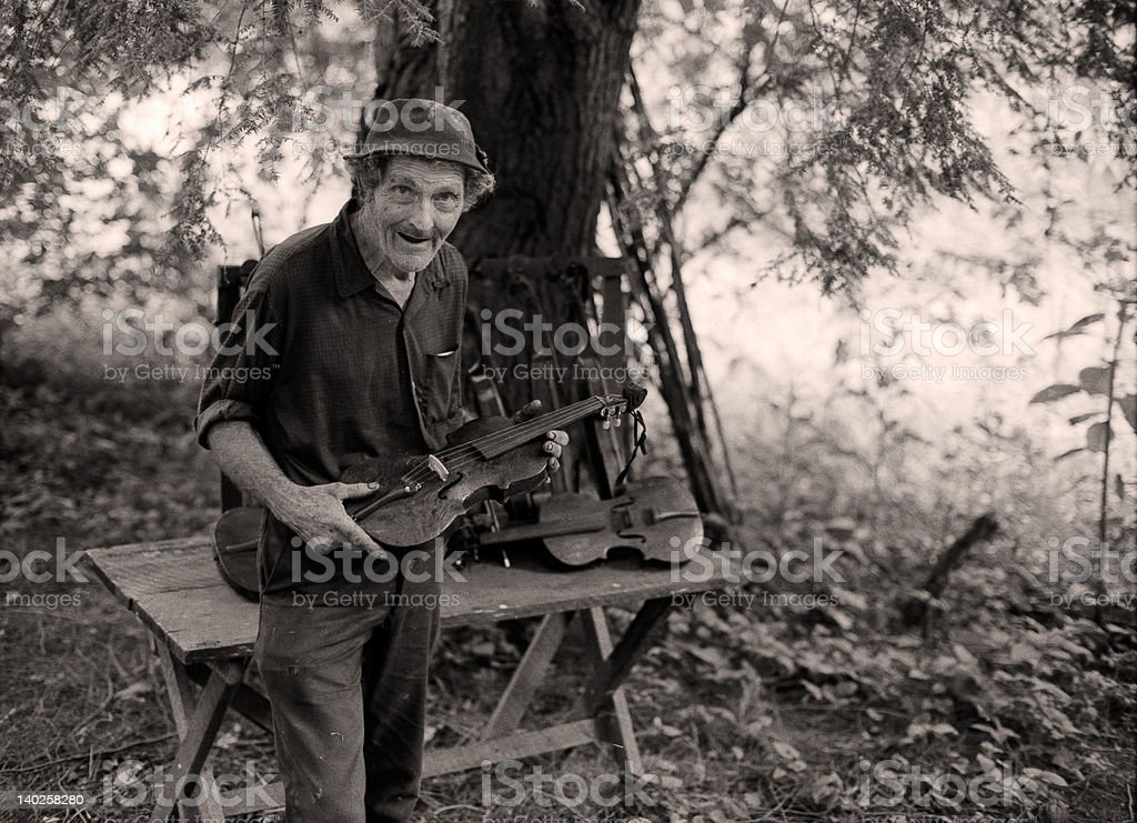 Old time fiddle maker (1980) stock photo