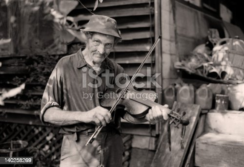 istock Old time mountain fiddle player (1980) 140258269
